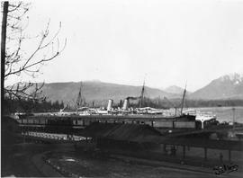 Empress of India at Vancouver dock; first Canadian Pacific Railway station in foreground.
