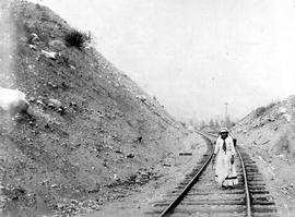 A Klootchman on the Canadian Pacific Railway tracks