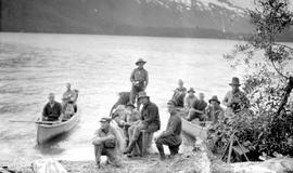 Survey party and geological survey crew at Eutsuk Lake; Frank Swannell in the Dutch cap at the right of centre on shore.