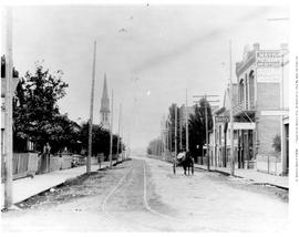 Maynards Photographic Gallery On Pandora Street, East Of Douglas Street; First Presbyterian Church At The Left, At The Northwest Corner Of Pandora And Blanshard Street.