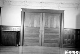 "Double pocket-doors and inset panelling; ceiling moulding also visible; George H. Aylard's residence ""Stonehaven"", 625 Elliot Street, Victoria; just prior to being demolished"