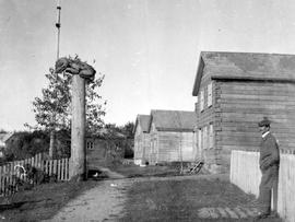 An unidentified street scene; First Nations settlement.