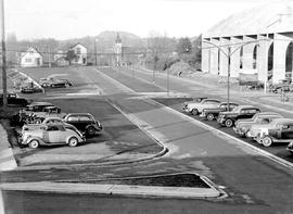 Parking lot for the Hudson's Bay Store, Victoria; Memorial Arena under construction at the r...