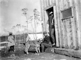 Dr. Henry Esson Young with his dog Bessie in Atlin.