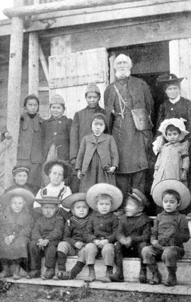"""The mission school at Carcross""; Bishop and Mrs. Bompas with schoolchildren; photo tak..."
