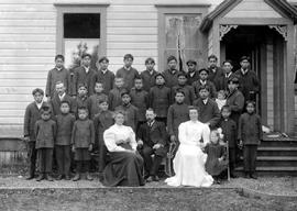Group photo showing Indian boy students at a schoolhouse in Alert Bay, BC