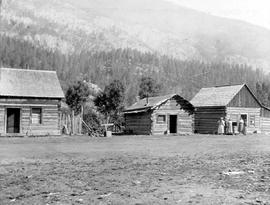 A small group of log cabins.