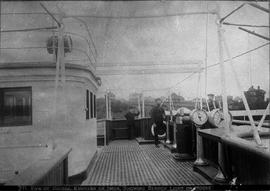 """View of bridge, Empress of India, showing search light on house""."
