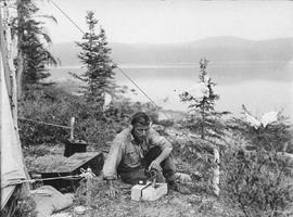 Guy Houghton Blanchet using a wireless radio in the bush.