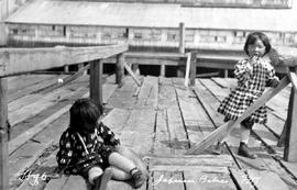 Richmond canneries, two little Japanese girls play on the wharf.