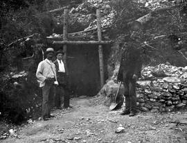 Three men standing in front of the entrance to the D.A. Mine, Greenwood.