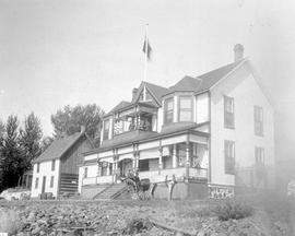 Kamloops Museum photo; Residence of William Fortune at Tranquille, near Kamloops; believed to be William Fortune in cart in front of house