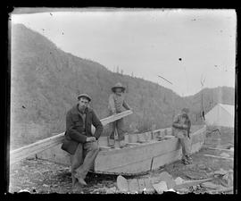 Unidentified men with scow