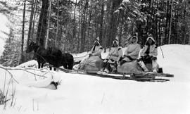 Survey party on the Nechako Road using Constanineau's sled for transport.