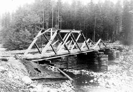 """Bridge over south forks of Nanaimo River (Junk Creek), Sep 1930"", No. 76."