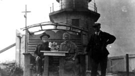 Cape St. James Lighthouse; lighthouse-keeper Stanley Lawrence and his wife Jessey, seated, Revere...