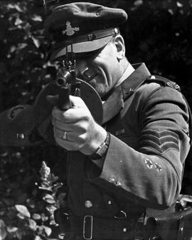 A BC Provincial Police Officer showing his tommy gun