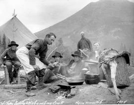 Oil claim survey camp at Kishe-neh-na Creek; cook frying venison.