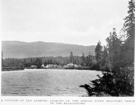 """A portion of Old Alberni; looking up the Somass River; Beaufort Range in the background."""
