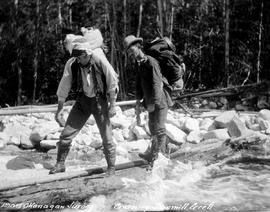 """1905 Okanagan survey, crossing Sawmill Creek""; surveyors Frank Swannel at left and Geo..."