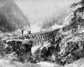 Balloon bridge; looking down the Fraser River from China Bar Bluff; from Onderdonk albums