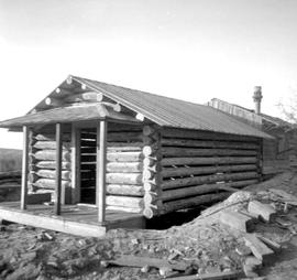 Fort Steele during restoration; rebuilding a log cabin.