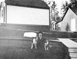 The General Manager of  West Kootenay Power and Light Co. Ltd., Rossland, with his dogs.