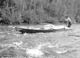 Canoe in rapids on the Driftwood River.