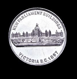 "Obverse of medallion with legislative buildings and inscription ""New Parliament Buildings/Victoria BC 1897""."