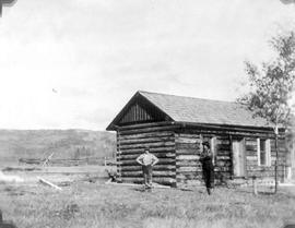 A newly completed cabin; G. Kirkpatrick and G. Daniel.