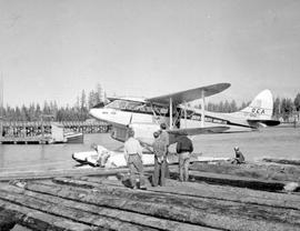 Queen Charlotte Airlines unloading passengers at Masset