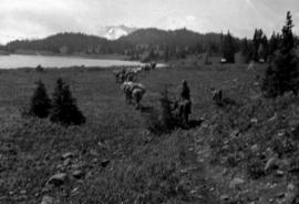 Survey crew passing Sitkatapa Lake, one of the Mackenzie landmarks.