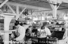 Richmond canneries; Japanese women with babies ont their backs; filling cans.