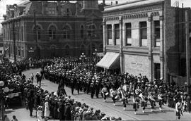 A parade of sailors from HMS Kent, proceeding east on Pandora Avenue from Douglas Street, Victori...