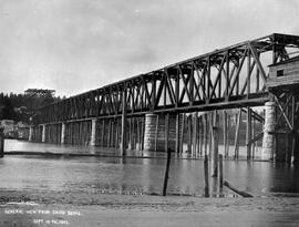 """General view from south shore""; construction of the Fraser River Bridge in New Westmin..."