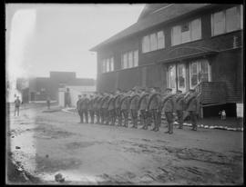 Soldiers standing at attention, Work Point Barracks