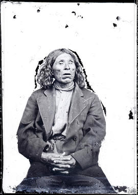 Studio portrait (mid-length) of an unidentified Indigenous individual taken at a photographic stu...