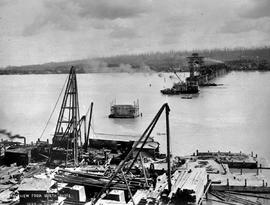 """General view from north shore""; construction of the Fraser River Bridge in New Westmin..."