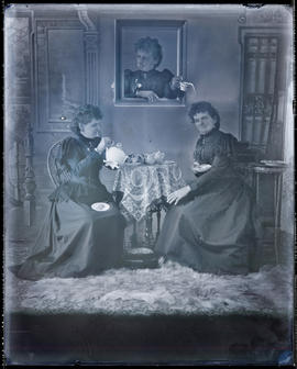 Tableau vivant featuring multiple (three) Hannah Maynards in a studio attributed to Mrs. R. Mayna...
