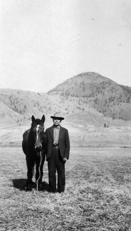 A First Nations man with his horse; Kamloops.