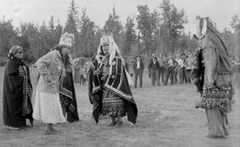 Carrier Indians dancing a welcome dance; this would sometimes go on for two or three days until a...