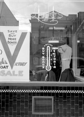 Victory Bond promotional poster in the window of Lyle's Dress Shop, 1441 Douglas Street, Vic...