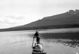 Surveyor Frank Swannell rafting on Kitchener Lake.