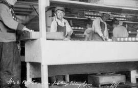 """BC canneries, Jap boys filling cans""; Japanese boys hand packing tin cans in plant, ti..."