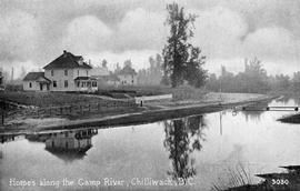 """Homes along the Camp River, Chilliwack, BC."""
