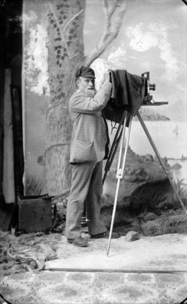 Photographer Richard Maynard with field camera on tripod inside Hannah Maynard's studio, Vic...