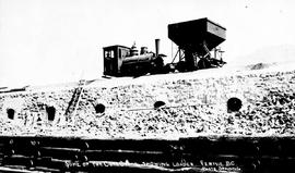 """Some of the coke ovens, showing loader; Fernie BC""."