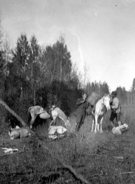 "Breaking camp at ""Lost Meadow"" on the V.W.N. and Yukon Railway survey."