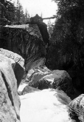 Swannell Survey; Waterfall through a rocky chasm.