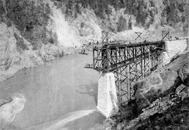"""Building a cantilever bridge going west""; Canadian Pacific Railway, near Cisco Flat so..."
